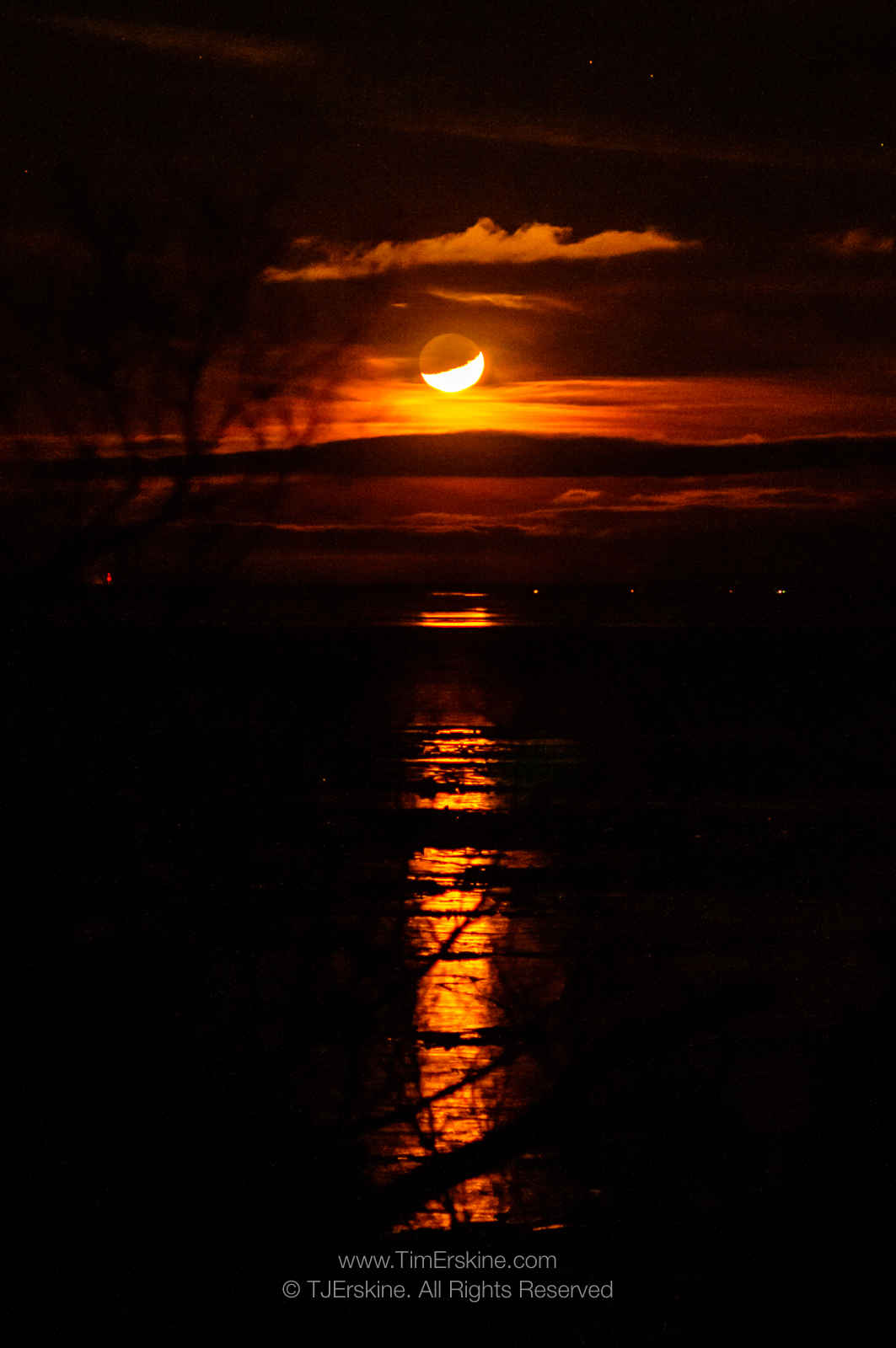 Amber Crescent Moonset